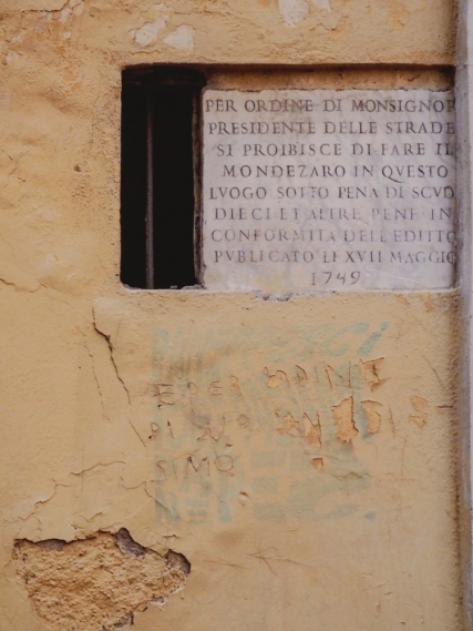An inscription from 1749 prohibiting Romans from leaving their trash here.