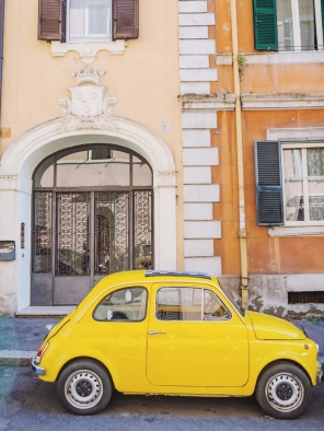 A 'shocking yellow,' beautifully maintained vintage Fiat 500.