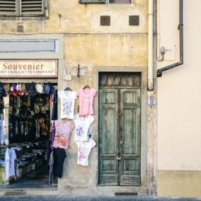 A souvenir shop and a well-worn door.
